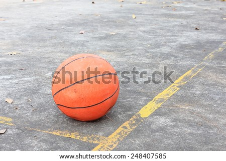 Basketball is placed on the cement floor. - stock photo