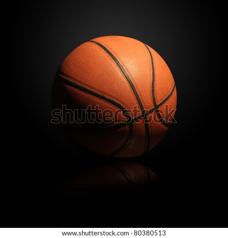 Basketball isolated on black background with light effect and reflection - stock photo