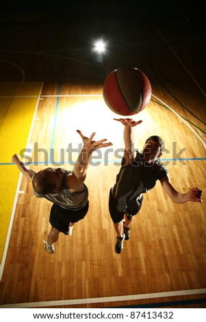 Basketball jump - dark silhouettes - stock photo