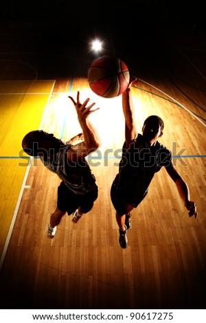Basketball jump - dark silhouettes - stock photo