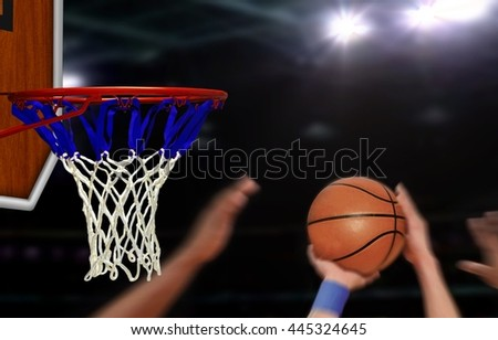 Basketball jump shot to the hoop by player - stock photo