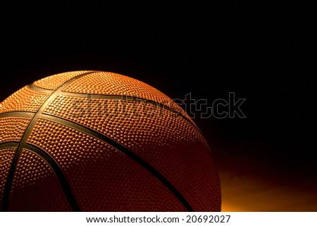 Basketball left on the gym floor - stock photo