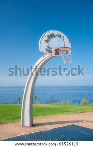 Basketball net at park under bright blue sky. - stock photo