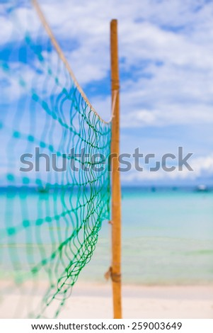 Basketball net on the tropical white beach - stock photo