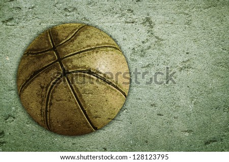 Basketball old ball on grunge concrete background - stock photo