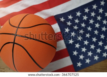 Basketball on American flag at the top view - stock photo