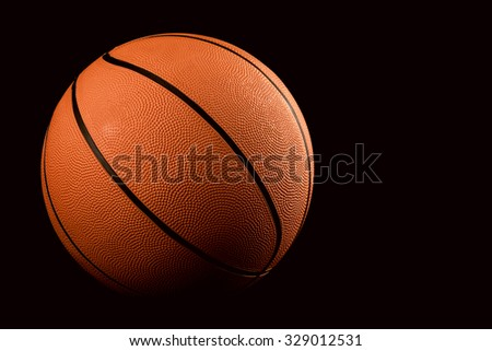 Basketball on black background - stock photo