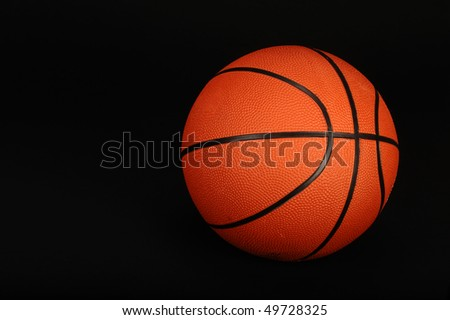 Basketball on black background ready for your type. - stock photo