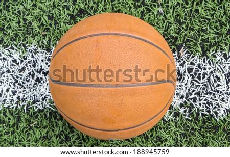 Basketball on grass - stock photo