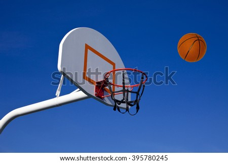 Basketball on its way to an outdoor hoop