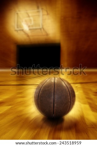 Basketball on wooden floor of old basketball court - stock photo
