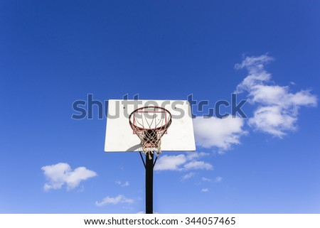 Basketball Outdoor Basketball court net hoop ring board outdoor outside blue sky. - stock photo