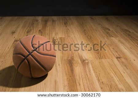 Basketball over wooden floor. Close up. - stock photo