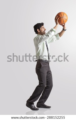 Basketball player about to throw a ball - stock photo