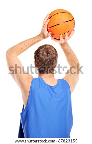Basketball player aiming to shoot a ball isolated on white background - stock photo