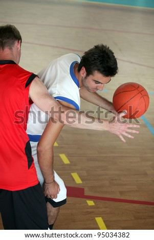 Basketball player blocking - stock photo