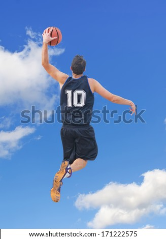 basketball player dunking in the sky