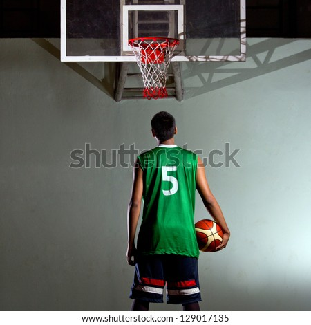 Basketball player hold the ball for his game - stock photo
