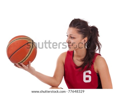 Basketball player holding basket ball, isolated on a white background - stock photo