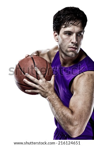 Basketball player on a  purple uniform, on a white background.