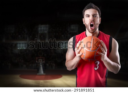 Basketball Player on a red uniform in the stadium