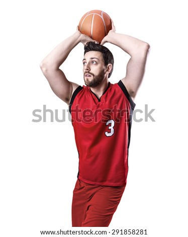 Basketball Player on a red uniform isolated on white background - stock photo