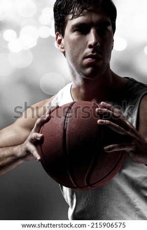 Basketball player on a  white uniform, on a white lights background.