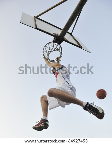 basketball player practicing and posing for basketball and sports athlete concept - stock photo