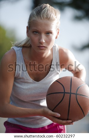 Basketball player ready to pass the ball - stock photo
