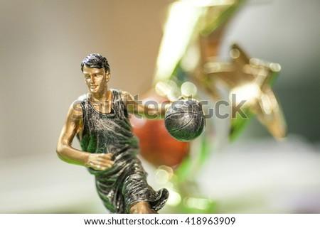 Basketball player's figure. Basketball cup. Gold basketball cup.  - stock photo