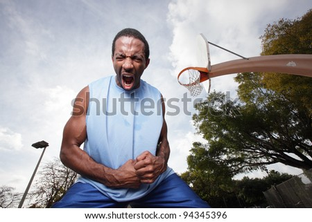 Basketball player screaming after his victory - stock photo