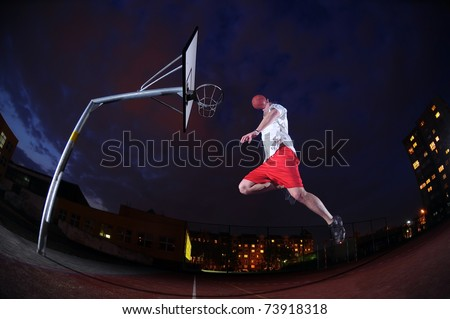 Basketball player slum dunking - stock photo