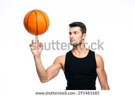Basketball player spinning ball on his finger isolated on a white background - stock photo