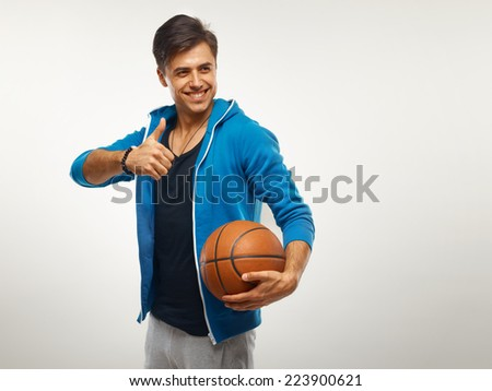 Basketball player standing with a basket ball  - stock photo