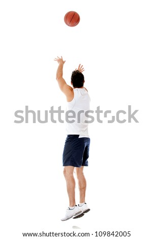 Basketball player throwing the ball - isolated over a white background - stock photo
