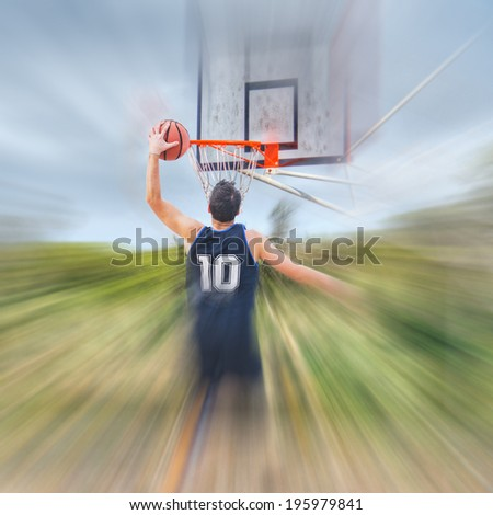 basketball player under a cloudy sky - stock photo