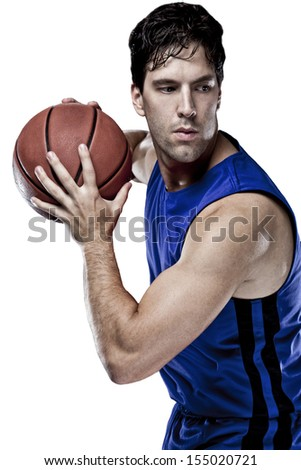 Basketball player with a ball in his hands and a Blue uniform. On a white Background