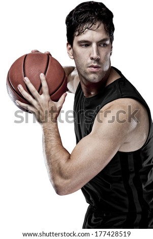 Basketball player with a Black uniform on a white background.
