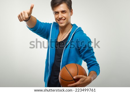 Basketball player with ball against white background