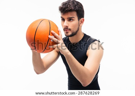 Basketball player with ball isolated on white background. Looking away