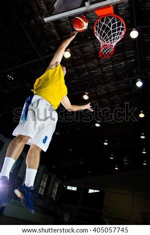 Basketball players competition game sport in stadium.