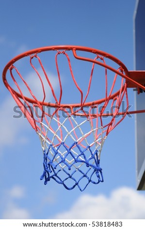 basketball ring in a blue sky background. - stock photo