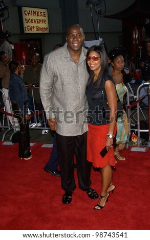 Basketball star EARVIN MAGIC JOHNSON & wife at the world premiere, at the Mann's Chinese Theatre, Hollywood, of Rush Hour 2. 26JUL2001   Paul Smith/Featureflash