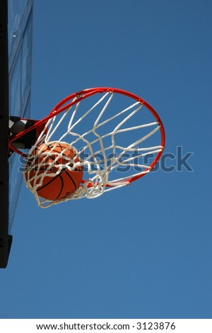 Basketball Swishing Through Net