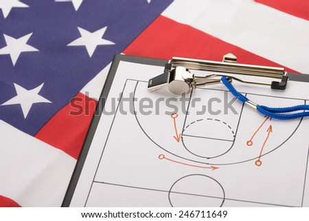 Basketball Tactics On A Sheet Of Paper And Whistle On American Flag - stock photo
