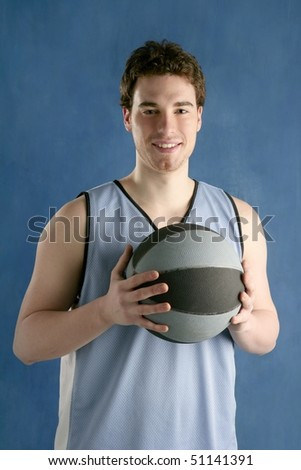 basketball young man basket player portrait over blue studio background - stock photo