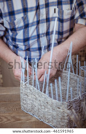 basketry. Man weaves basket