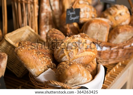 baskets of bread on a shelf, in a bakery store - stock photo