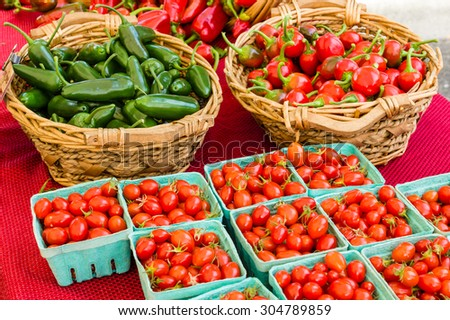 Baskets of hot peppers and cherry tomatoes at the market