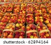 Baskets of peaches at a farmer's market. - stock photo